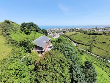 Fabulously located Cloud Nine nestled amongst the trees above Port Isaac, North Cornwall.