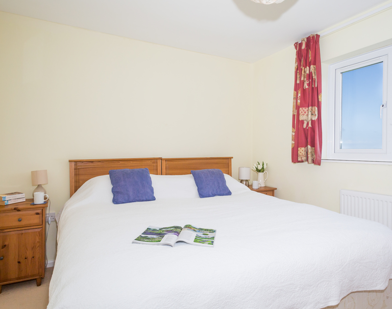 The superking bedroom at self catering, holiday property Trevic in Polzeath, Cornwall.