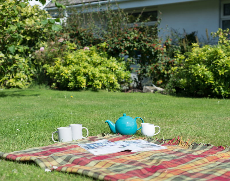 Make the most of the large lawn with tea or a picnic at self catering, holiday house Treperran in Trebetherick,North Cornwall.