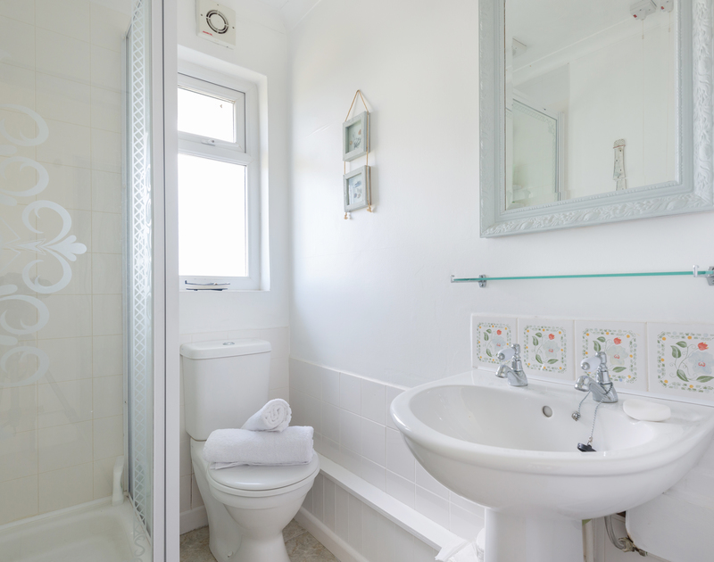 The shower ensuite for the super king bedroom at Treperran, a self catering, holiday house ideally situated between Polzeath and Daymer bay in North Cornwall.