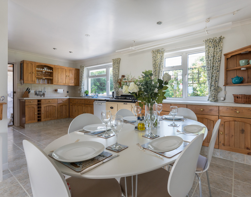 Make the most of the cream AGA and gather the family round the dining table in the country kitchen at self catering holiday house Treperran near Daymer Bay in Cornwall.