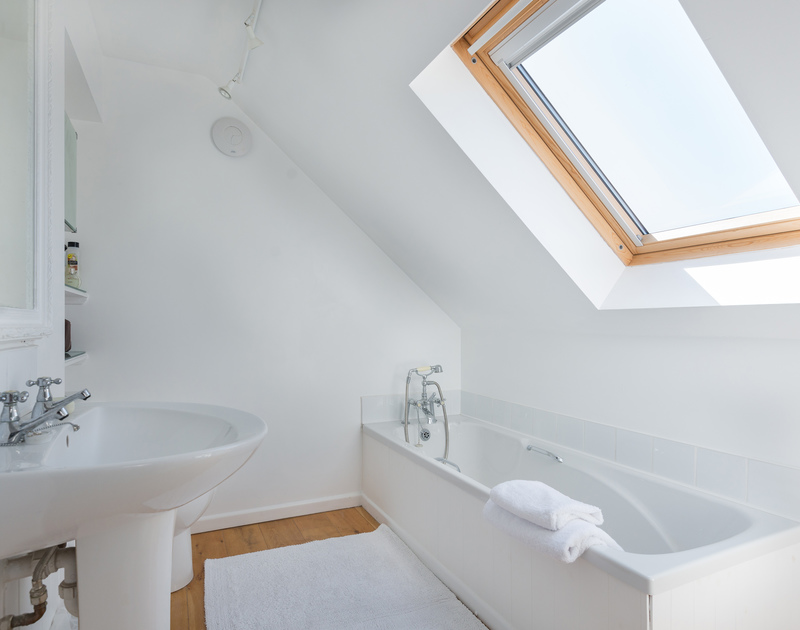The bathroom ensuite for the master bedroom with a skylight at self catering, holiday house Treperran near Daymer Bay in North Cornwall.