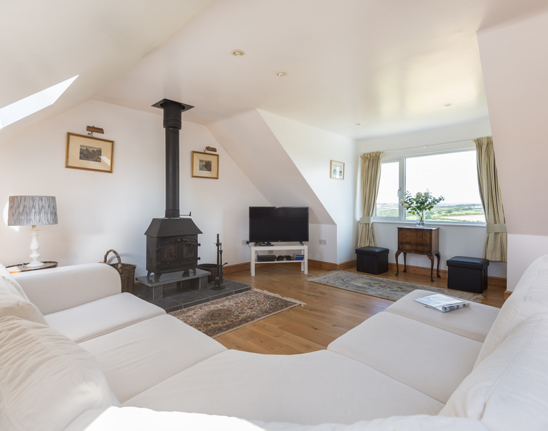 Take some time to relax on the huge corner sofa in the living room at self catering holiday house Treperran, ideally situated between Daymer Bay and Polzeath.