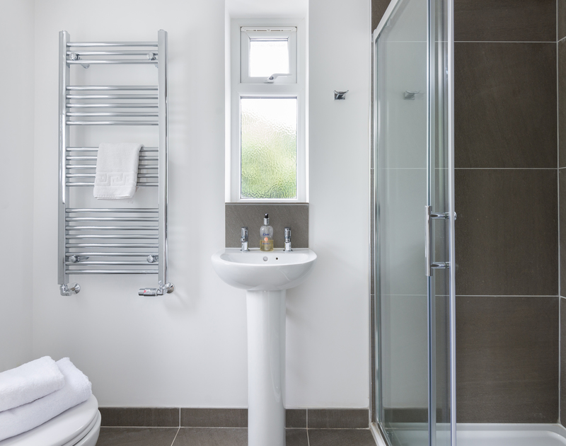 A useful ground floor shower room leading off from the utility room at Signal Post, a self catering holiday house to rent in Port Isaac in Cornwall.
