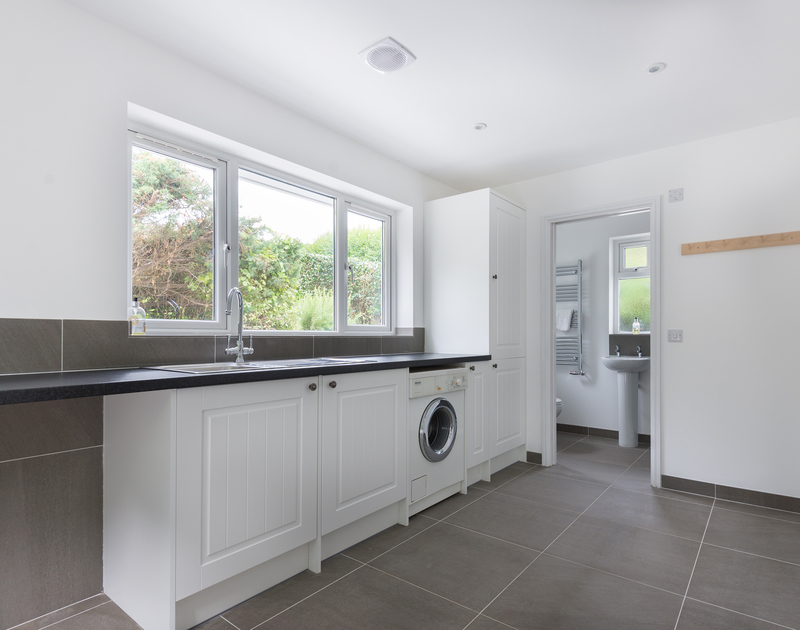 Plenty of space to kick off your shoes and hang towels or coats up in the utility room at Signal Post, a self catering holiday house to rent in Port Isaac.