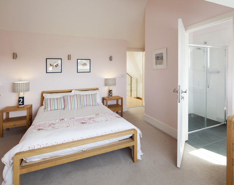 The double bedroom on the first floor at Greenaway Reach, near Daymer Bay in north Cornwall has an ensuite shower room and sea views.