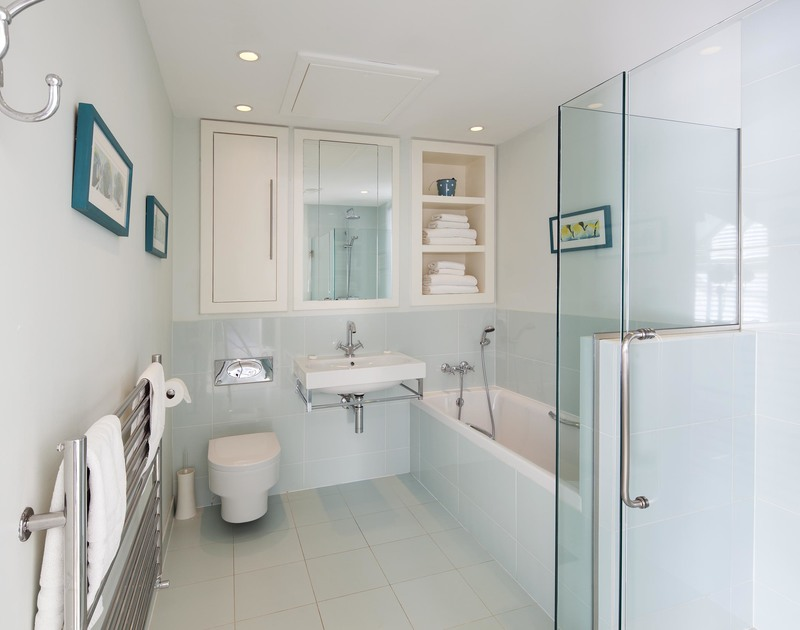 The ensuite bathroom to bedroom 6 at Greenaway Reach, a self catering holiday house to rent near Daymer Bay, North Cornwall, has both a bath and shower.