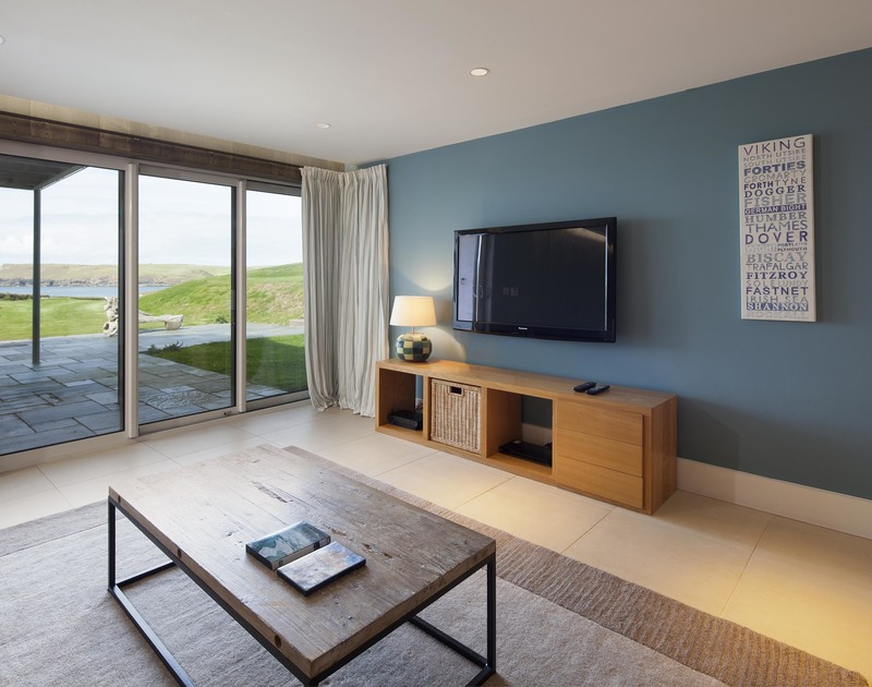 You might get distracted by the sea views from the TV room at Greenaway Reach, a luxury holiday home to rent in Daymer, Cornwall