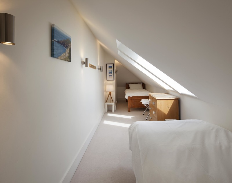 The compact children's twin room is set under the eaves at Greenaway Reach, a holiday house to rent in Daymer, Cornwall