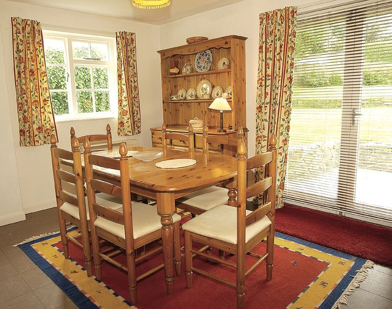 The dining room of White House, a charming holiday cottage near Rock, Cornwall