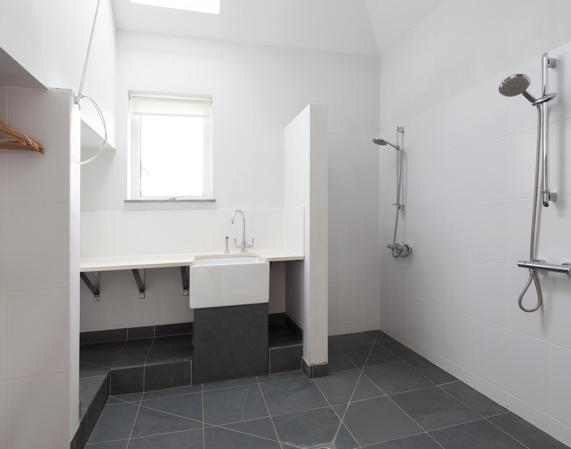 The spacious wet room off the main hallway at Greenaway Reach is perfect for drying wetsuits, with direct access to the garden