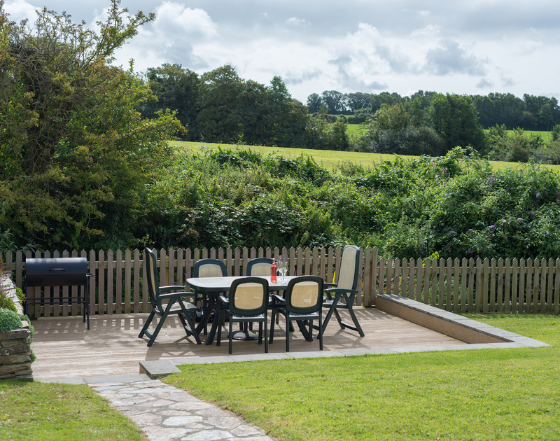 Decked, terrace area at self catering, holiday rental, Willowbrook, perfect for alfresco dining in Rock, Cornwall.