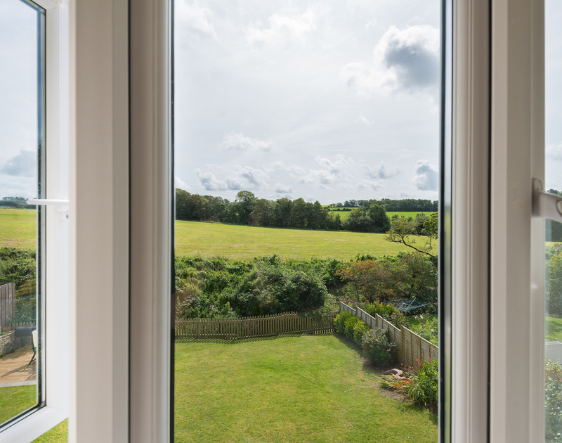 Elevated rural views from the upstairs double bedroom window at Willowbrook in Rock, Cornwall.