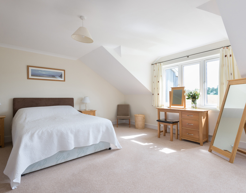 The spacious and light double bedroom of Willowbrook, an attractive holiday rental in Rock, Cornwall