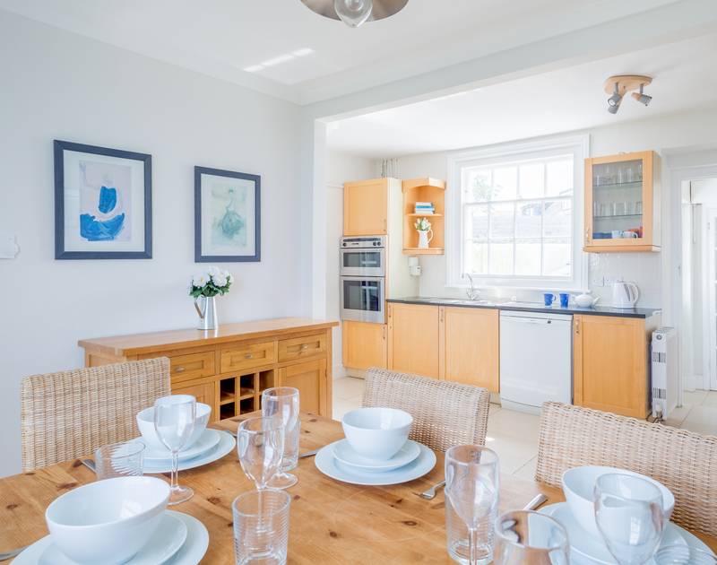 The open plan kitchen/dining room at Coastguard cottage 3, a seafront, self catering holiday house to rent in a stunning location on the clifftop above Port Isaac in North Cornwall.