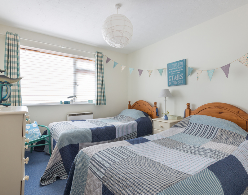 An attractive twin bedroom at Rocklings, a holiday house to rent in Rock, Cornwall