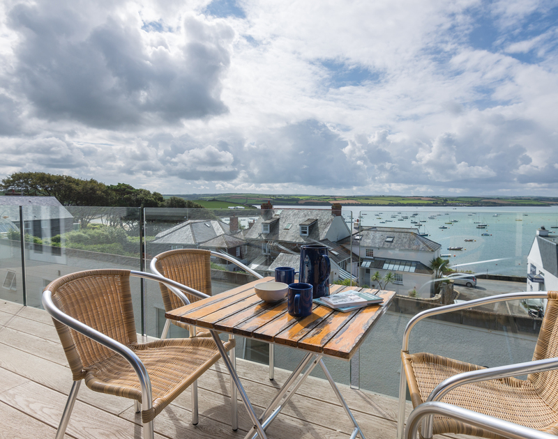 Morning coffee, lazy lunches or evening drinks on the balcony at self catering holiday rental Slipway 23, overlooking the bobbing boat moorings on the Camel Estuary in Rock.