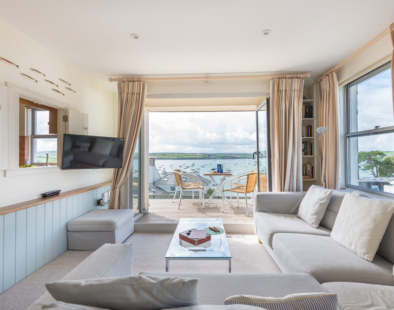 Amazing sea views from the sitting room and balcony of Slipway 23, a holiday cottage to rent in Rock, Cornwall