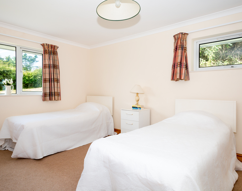 The first of two twin bedrooms at  self catering Turnstones in Daymer Bay.