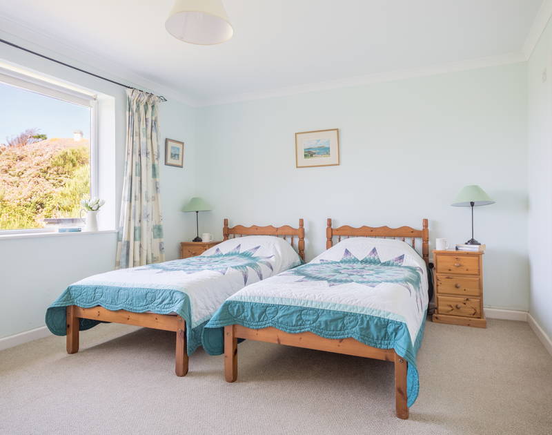 One of two twin bedrooms with ensuite shower at self catering, holiday rental Higher Crawallis.