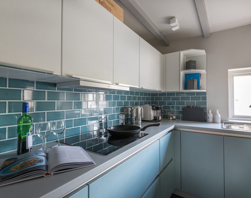 The well equipped, cool and modern kitchen in Creel Cottage, a self catering holiday rental in Port Isaac.