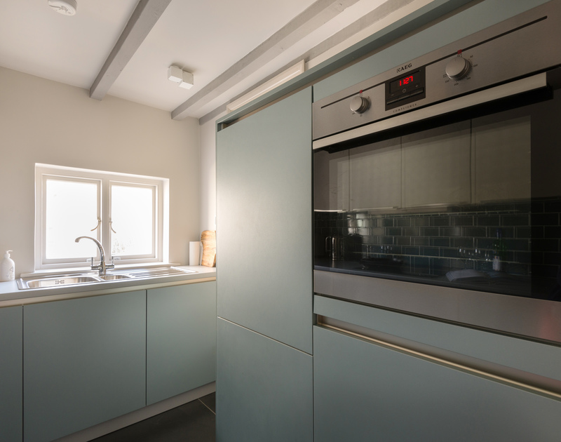 Make use of the contemporary AEG oven in the kitchen at Creel Cottage, a self catering holiday retreat in Port Isaac in North Cornwall.