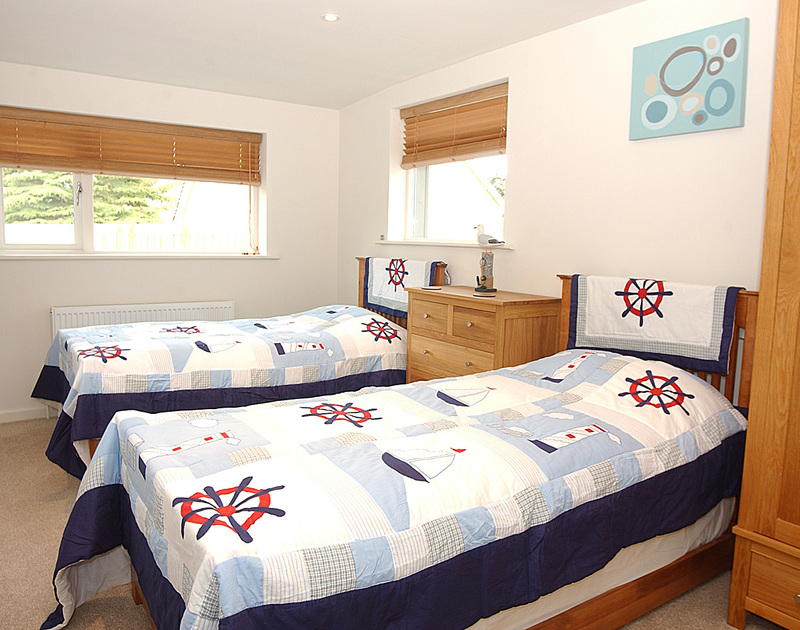 The twin bedroom at Penolver Lodge in Rock has shared use of the family shower room