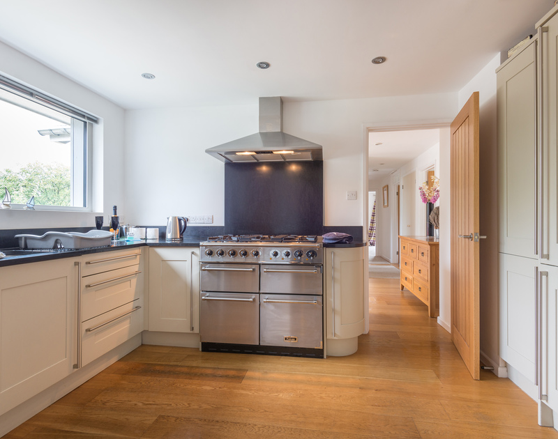 Prepare wonderful family meals in the contemporary kitchen at Penolver Lodge, a self catering holiday house to rent in Rock, Cornwall