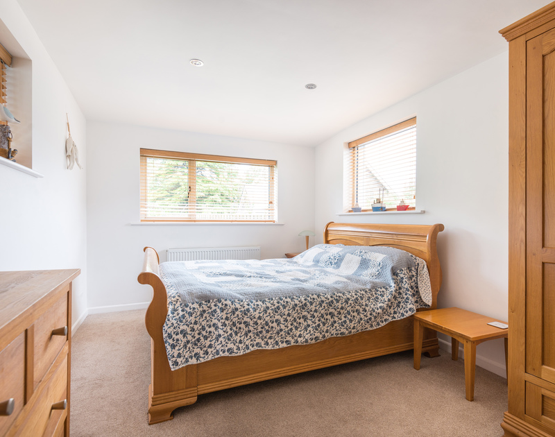 One of three light and spacious king size bedrooms at Penolver Lodge, a holiday house to rent in Rock, North Cornwall