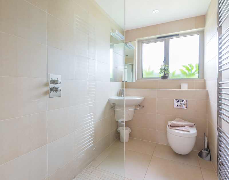 A stylish and modern walk in shower room is ideal for family holidays at Penolver Lodge in Rock, north Cornwall