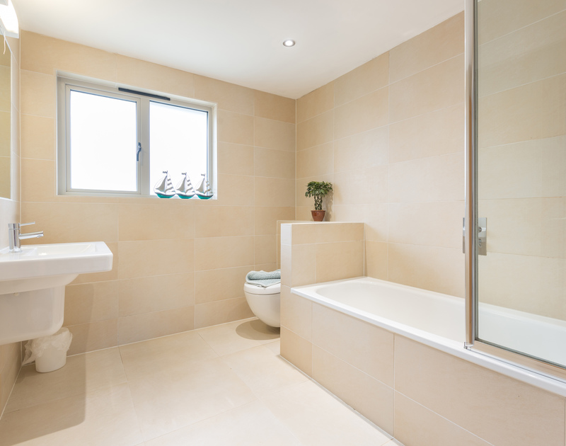 The master suite at Penolver Lodge in Rock, offers an en-suite bathroom with over bath shower