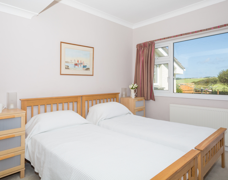 One of two twin bedrooms at self catering, holiday rental Little Belz in Polzeath.