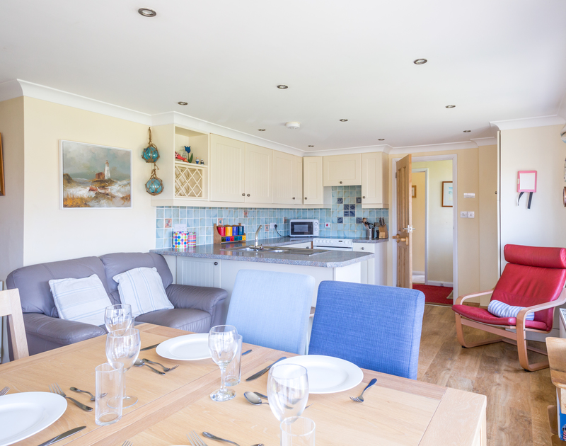 Open plan kitchen/dining room at self catering Little Belz in Polzeath.