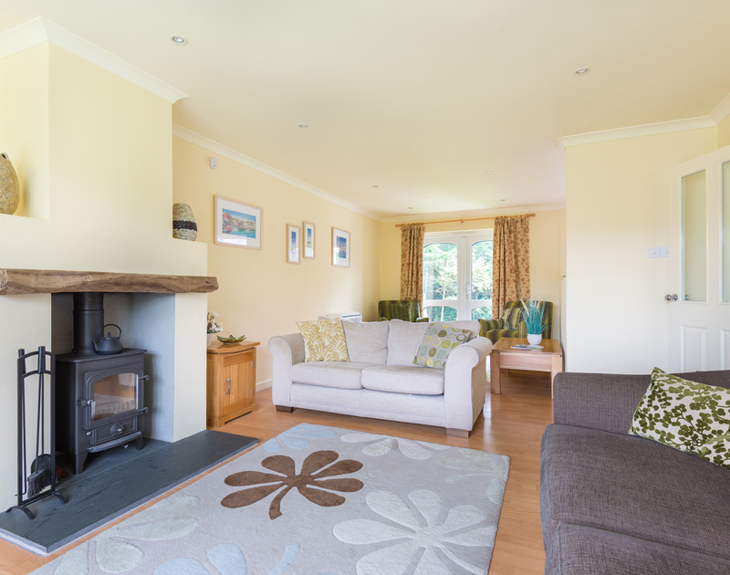 Cosy up in the sitting room at holiday rental Silverdale and light the woodburner on cooler evenings.