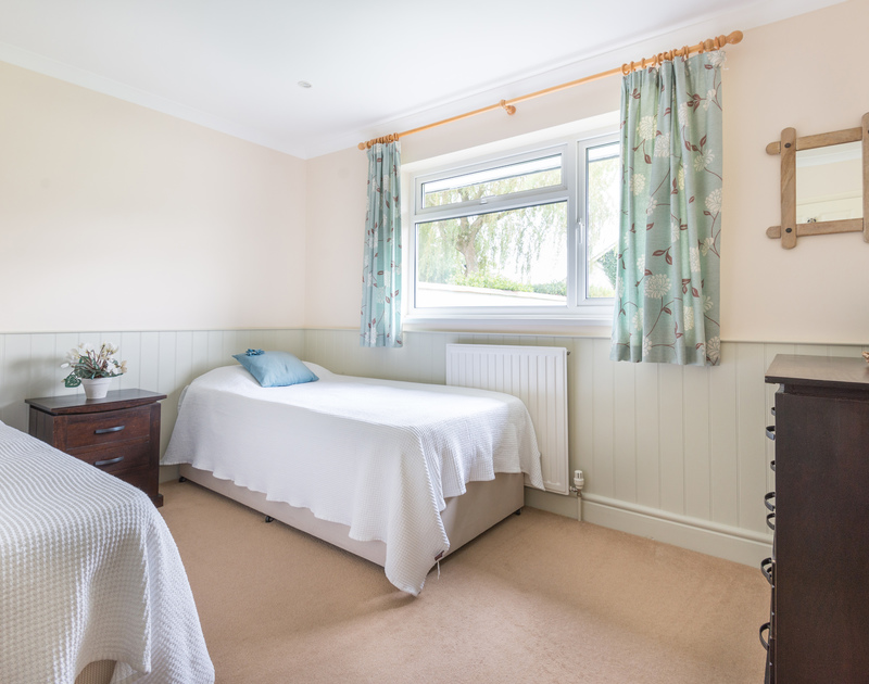 One of the bright twin bedrooms on the ground floor at Silverdale