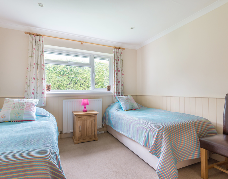 One of the twin bedrooms with a view out over the garden at Silverdale in Rock.