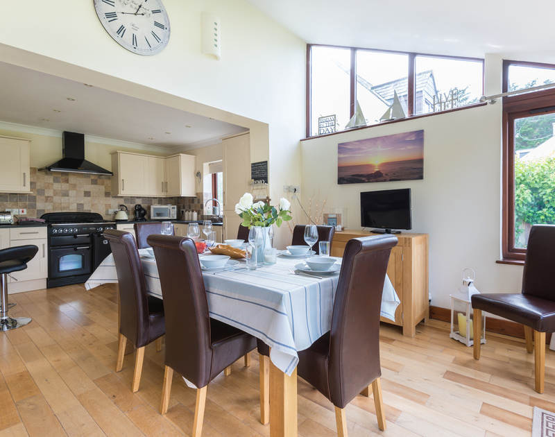 The open plan kitchen/dining room at Gulls Cottage, a family, holiday house to rent in Rock, Cornwall.