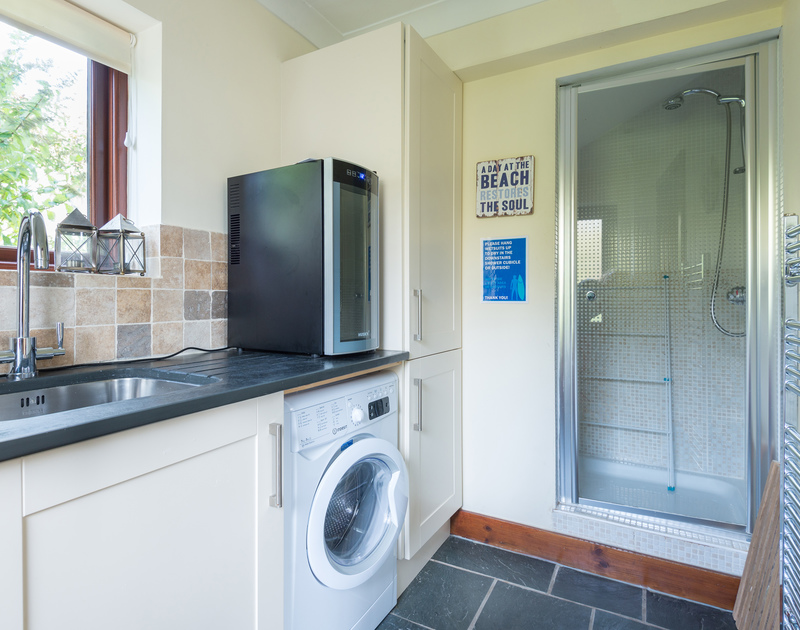 Useful utility room with shower at Gulls Cottage, a holiday house to rent in Rock.
