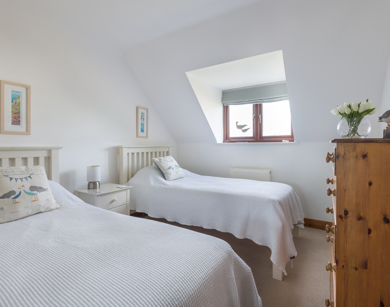 The comfy, bright, twin bedroom of Gulls Cottage, a holiday rental in Rock, Cornwall