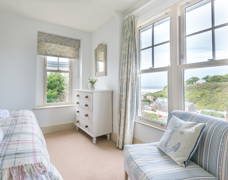Sea views from one of the double bedrooms at Westray House, a self catering, holiday house a short stroll from the village and beach in Polzeath.