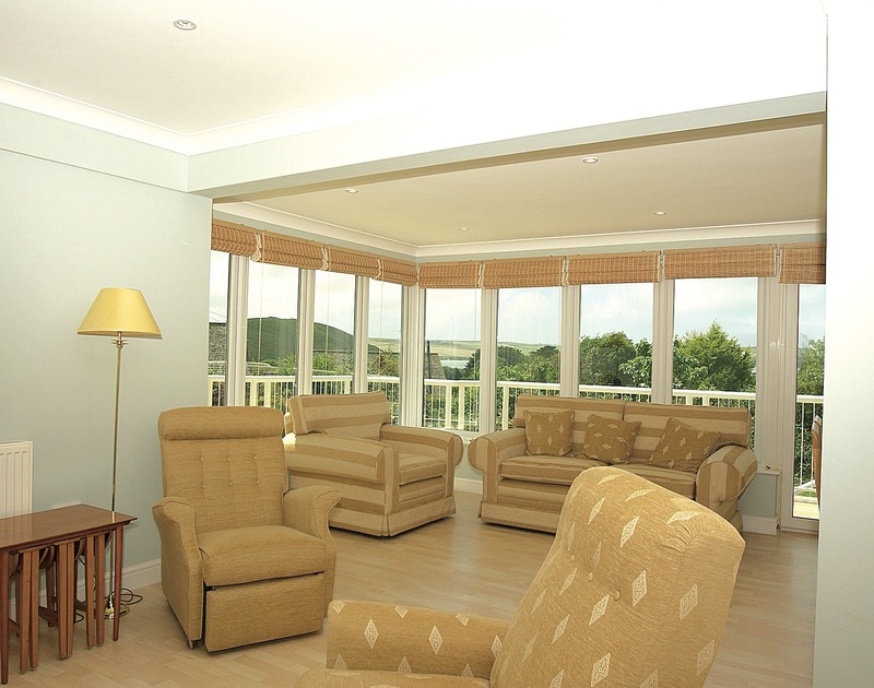 Beautiful views of Brea Hill and the estuary from the lounge of Thyme Bank, a holiday house at Daymer Bay, Cornwall