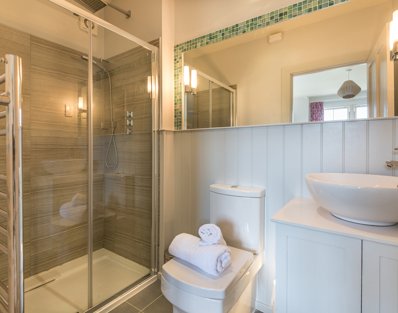 The en-suite modern shower room at Westray House, a refurbished self catering holiday house by the sea in Polzeath, Cornwall.