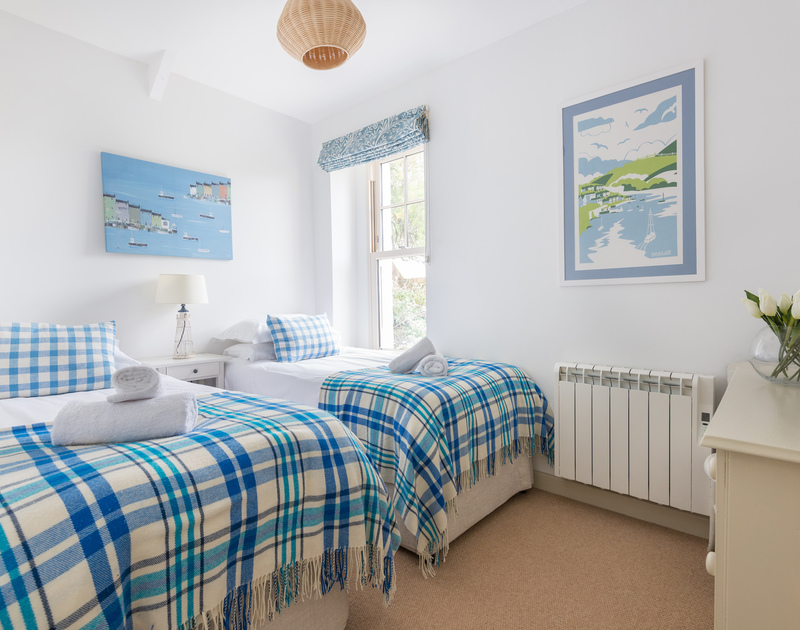 Cool blues and whites in the twin bedroom at self catering, holiday rental Westray House in Polzeath, Cornwall.