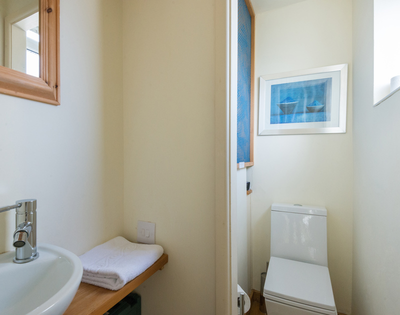 Compact WC on the first floor at self catering holiday rental Beachside in Polzeath, Cornwall.
