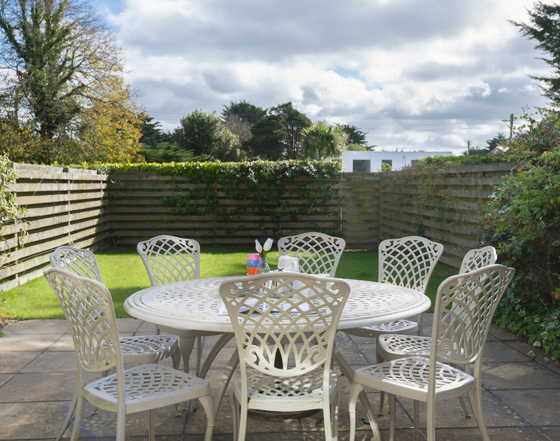 The sunny paved terrace of Lowenna Manor 5, a self-catering holiday house in Rock, Cornwall