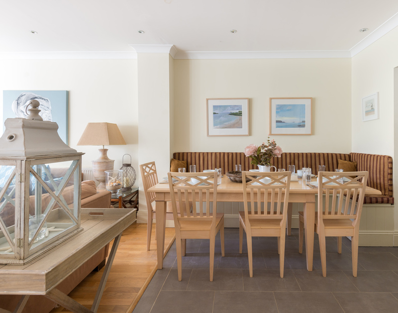 The open-plan dining room of Lowenna Manor 5, a self-catering holiday house in Rock, Cornwall