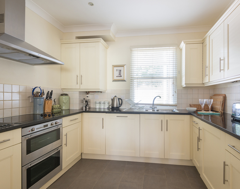 The attractive, modern kitchen of Lowenna Manor 5, a self-catering holiday house in Rock, Cornwall