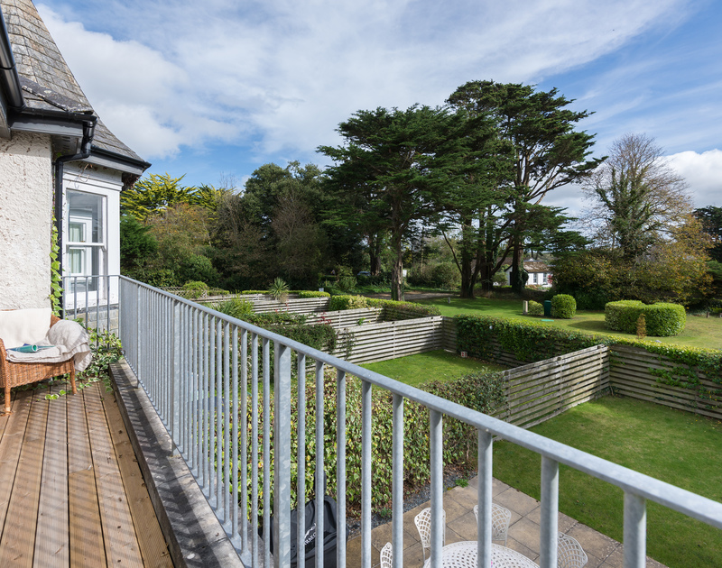 The master bedroom has a decked balcony providing a private suntrap at lowenna Manor 5, a self catering holiday house to rent in Rock, Cornwall.