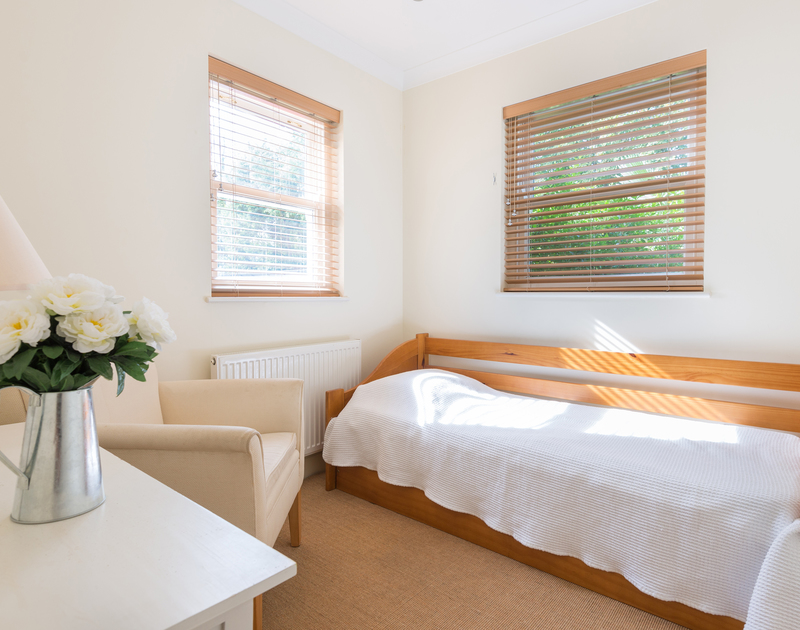 A light, single bedroom with two windows at self catering, holiday house Lowenna Manor 5 in Rock, Cornwall.