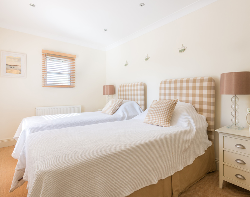 Lowenna manor 5, is a contemporary holiday cottage on the Rock road in Rock, North Cornwall, there are four zip and link bedrooms providing flexibility for guests.